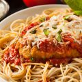 Homemade chicken parmesan on top of noodles