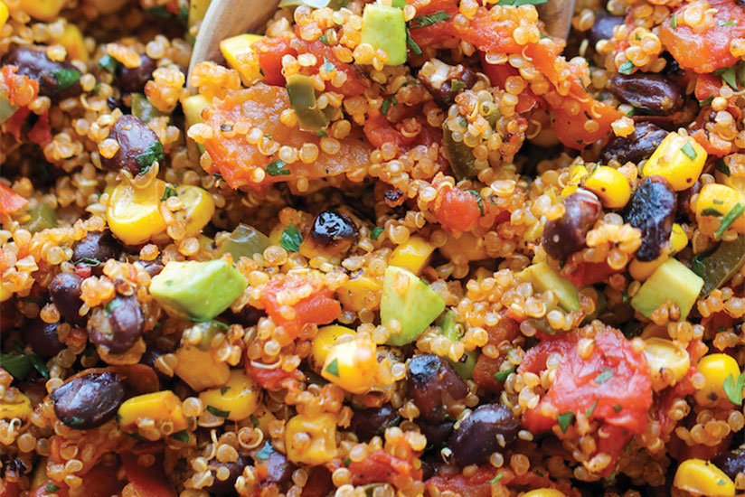 One pan Mexican quinoa salad with avocado slices and black beans