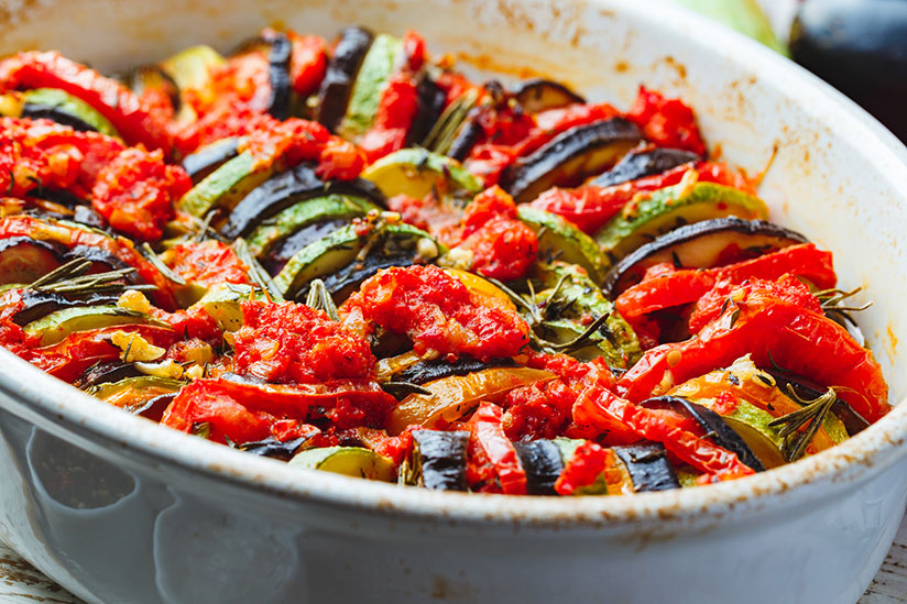 Vegetable ratatouille in white dish on counter