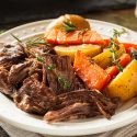 Crockpot roast beef with potatoes and carrots on plate